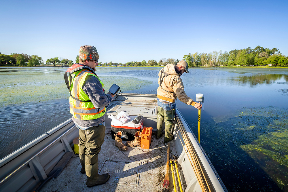 Fenstermaker survey technicians Erick Kidder, left, and Kyle Lanclos map the depth of City Park Lake for the next phase of the University Lakes Project plan to restore the six lakes surrounding the LSU campus.
