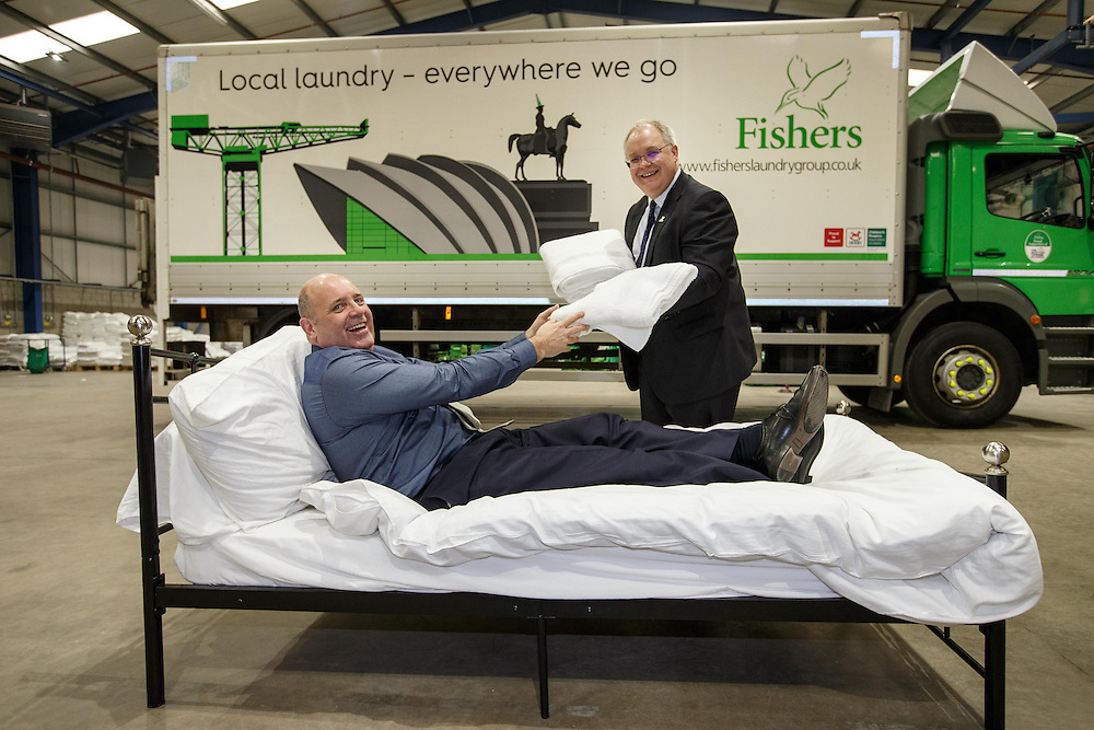 FREE PICTURES : Michael Jones MD of Fishers Laundry and Marc Crothall CEO  (in bed) of The Scottish Tourism Alliance play it for laughs at Fishers' super laundry opening in Coatbridge. Picture Robert Perry 17th March 2016<br /> <br /> Please credit photo to Robert Perry<br /> <br /> Image is free to use in connection with the promotion of the above company or organisation. 'Permissions for ALL other uses need to be sought and payment make be required.<br /> <br /> <br /> Note to Editors:  This image is free to be used editorially in the promotion of the above company or organisation.  Without prejudice ALL other licences without prior consent will be deemed a breach of copyright under the 1988. Copyright Design and Patents Act  and will be subject to payment or legal action, where appropriate.<br /> www.robertperry.co.uk<br /> NB -This image is not to be distributed without the prior consent of the copyright holder.<br /> in using this image you agree to abide by terms and conditions as stated in this caption.<br /> All monies payable to Robert Perry<br /> <br /> (PLEASE DO NOT REMOVE THIS CAPTION)<br /> This image is intended for Editorial use (e.g. news). Any commercial or promotional use requires additional clearance. <br /> Copyright 2016 All rights protected.<br /> first use only<br /> contact details<br /> Robert Perry     <br /> 07702 631 477<br /> robertperryphotos@gmail.com<br />        <br /> Robert Perry reserves the right to pursue unauthorised use of this image . If you violate my intellectual property you may be liable for  damages, loss of income, and profits you derive from the use of this image.