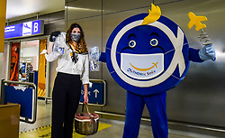 "Workers say a ""Hello"" with a smile and face mask as a gift  to the passengers that come to the Eleftherios Venizelos International Airport in Athens, Monday, June 15, 2020. Greece is officially open to tourists as of Monday, with the first international flights expected into Athens and the northern city of Thessaloniki where passengers will not face compulsory COVID-19 tests. Seasonal hotels and museums are also opening across the country. <br /> <br /> Pictured: <br /> Dimitris Lampropoulos  