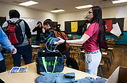 Emmely Arellano hands in her YONDR pouch at the end of Algebra 1 class at West High School in Madison, WI on Friday, April 12, 2019.