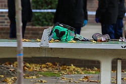 © Licensed to London News Pictures. 12/10/2020. London, UK. A first aid kit on a table tennis table within the crime scene in Homerton in Hackney, north London following triple shooting. Officers were called at 22:48hrs on Sunday, 11 October, to reports of a shooting on Homerton High Road in Hackney, and found three people with gunshot injuries. Two men, aged 60 and 32, were taken to hospital with non life-threatening/life-changing injuries. A third man, aged 24, was taken to hospital and remains in a life-threatening condition. Photo credit: Dinendra Haria/LNP
