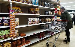 © Licensed to London News Pictures. 15/10/2021. London, UK. A shopper looks at nearly empty shelves of breakfast cereal in Sainsbury's, north London, amid fears of food shortages. The Government and retailers warn that food shortages could continue until Christmas due to labour shortages, following Brexit. Study research, conducted by delivery management experts Urbantz, reports that one in six Londoners reported that when they went food shopping, items they needed were not available and they could not find a replacement, while half of respondents said there was less variety of food in the shops than usual. Another 1-in-6 London residents were also unable to purchase fuel in the last fortnight. Photo credit: Dinendra Haria/LNP