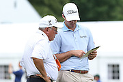 June 12 2013: Matt Harmon and his coach review the video footage of his putting motion on an iPad during the wednesday practice round at the 2013 U.S. Open hosted by Merion Golf Club in Ardmore, PA.