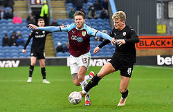 Burnley's Jeff Hendrick (left) and Barnsley's Cameron McGeehan (right) battle for the ball during the Emirates FA Cup, third round match at Turf Moor, Burnley.