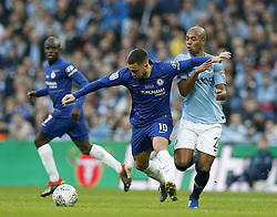 BRITAIN-LONDON-FOOTBALL-CARABAO CUP FINAL-CHELSEA VS MAN London.(190224) -- LONDON, Feb. 24, 2019  Chelsea's Eden Hazard vies with Manchester City's Fernandinho (R) during the Carabao Cup Final match between Chelsea and Manchester City at Wembley Stadium in London, Britain on Feb. 24, 2019. Manchester City won 4-3 on penalties after a 0-0 draw.  FOR EDITORIAL USE ONLY. NOT FOR SALE FOR MARKETING OR ADVERTISING CAMPAIGNS. NO USE WITH UNAUTHORIZED AUDIO, VIDEO, DATA, FIXTURE LISTS, CLUB/LEAGUE LOGOS OR ''LIVE'' SERVICES. ONLINE IN-MATCH USE LIMITED TO 45 IMAGES, NO VIDEO EMULATION. NO USE IN BETTING, GAMES OR SINGLE CLUB/LEAGUE/PLAYER PUBLICATIONS. (Credit Image: © Matthew Impey/Xinhua via ZUMA Wire)