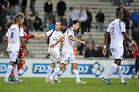 FOOTBALL - FRENCH LEAGUE CUP 2011/2012 - 1/8 FINAL - MONTPELLIER HSC v FC LORIENT - 26/10/2011 - PHOTO SYLVAIN THOMAS / DPPI - JOY LORIENT PLAYERS AT THE END OF THE MATCH