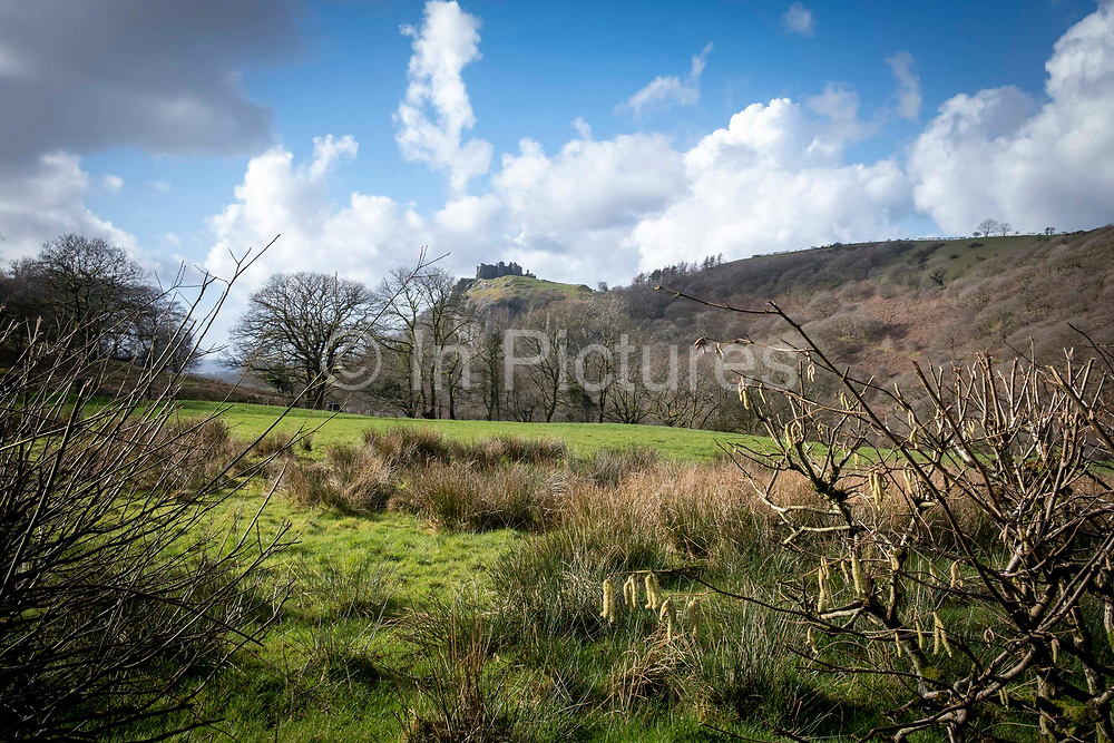 Carreg Cennen Castle at the top of a limestone cliffon 18th February 2019 in Trapp, Powys, Wales, United Kingdom. The castle has been in a ruinous state since 1462 and is under the care of Cadw, the Welsh Government historic environment service. The castle is on a working hill farm.