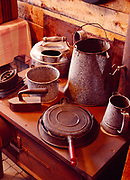 Cookware and iron  on stove in Miner's Kitchen, Keno City Mining Museum, Yukon Territory, Canada.