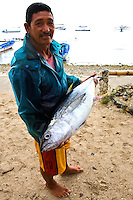 Filipino vendors roam around town early morning peddling their wares such as this man with his giant yellowfin tuna, his catch of the day.