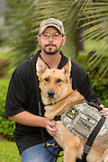 Wounded warrior Nick Bailley and his dog Abel on September 23, 2014 in Summerville, South Carolina. Young student Rachel Mennet led a successful fundraising effort using her lemonade stand to pay for training Abel to become a service dog for Nick.