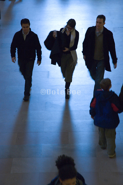 silhouette of a group of people walking