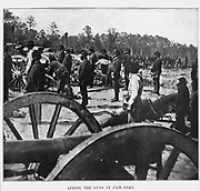 Aiming the Guns at Fair Oaks [The Battle of Seven Pines, also known as the Battle of Fair Oaks or Fair Oaks Station, took place on May 31 and June 1, 1862, in Henrico County, Virginia, as part of the Peninsula Campaign of the American Civil War. It was the culmination of an offensive up the Virginia Peninsula by Union Maj. Gen. George B. McClellan, in which the Army of the Potomac reached the outskirts of Richmond]. from the book ' The Civil war through the camera ' hundreds of vivid photographs actually taken in Civil war times, sixteen reproductions in color of famous war paintings. The new text history by Henry W. Elson. A. complete illustrated history of the Civil war
