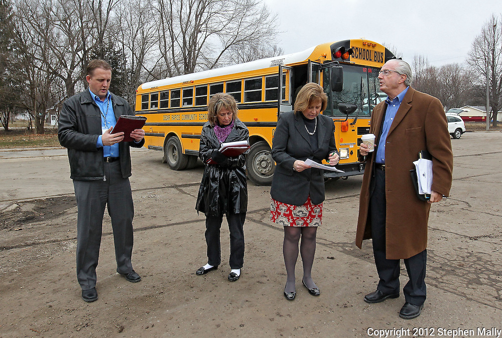 Cedar Rapids Recreation Superintendent Sven Leff (from left) and City Council members Ann Poe, Monica Vernon and Scott Olson look over the site of the former Time Check Recreation Center as members of the Northwest Recreation Center Task Force take a bus tour of the five possible sites for a new recreation center in Cedar Rapids on Thursday morning, February 23, 2012. (Stephen Mally/Freelance)