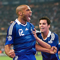 14 October 2008: French forward Thierry Henry #12 celebrates with Yoann Gourcuff (right) after scoring a first goal during the friendly football match won 3-1 by France over Tunisia on October 14, 2008, at the Stade de France in Saint-Denis, near Paris, France.