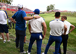 Team Europes' Viktor Hovland looks on with team-mates as Team USA win the Ryder Cup during day three of the 43rd Ryder Cup at Whistling Straits, Wisconsin. Picture date: Sunday September 26, 2021.