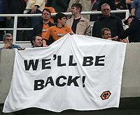 """Photo. Andrew Unwin.<br /> Newcastle United v Wolverhampton Wanderers, FA Barclaycard Premier League, St James Park, Newcastle upon Tyne 09/05/2004.<br /> """"We'll be back!"""", reads the banner of a young Wolves supporter."""