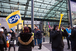 London, UK. 13th February, 2019. Public & Commercial Services (PCS) union members stand on the picket line with outsourced worker colleagues who walked out from the Department of Business, Energy and Industrial Strategy (BEIS) for their second day of strike action to demand the London Living Wage and an end to outsourcing. Union members handed out strike-themed cakes to supporters in return for donations to the strike fund.
