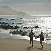 Couple walking on the beach. Cabo San Lucas, Mexico.