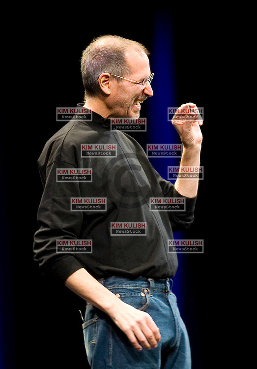 Apple CEO Steve Jobs  laughs as he holds the new Intel chip powering the new MacBook Air during the Macworld Convention and Expo in San Francisco January 15, 2008