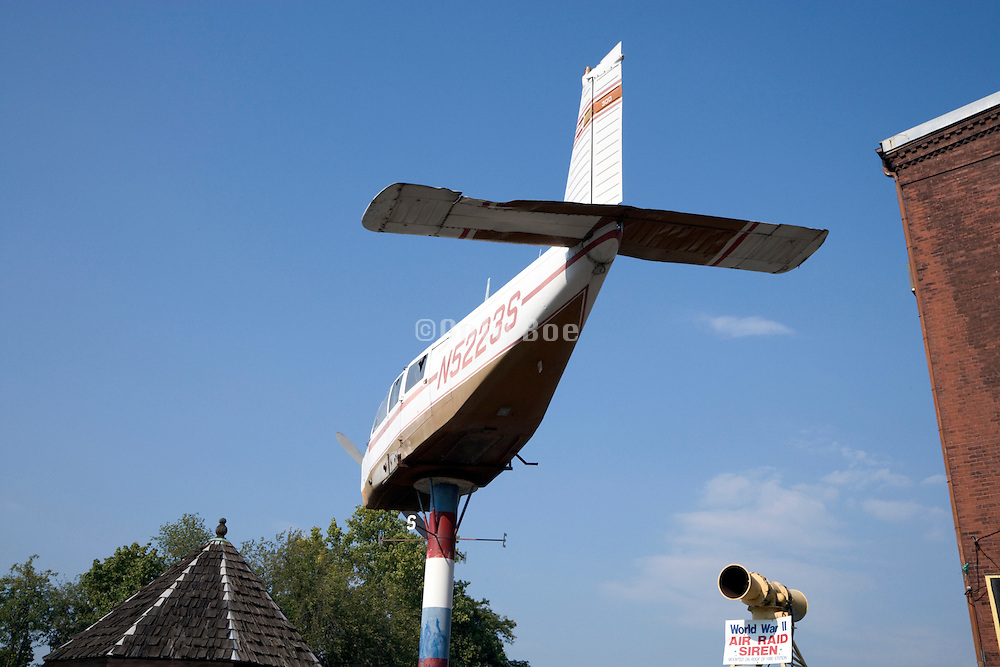 Small single engine aircraft placed on a pole and used as a wind direction pointer