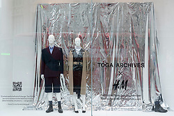 © Licensed to London News Pictures. 02/09/2021. London, UK. The TOGA ARCHIVES X H&M clothes collection in a window dispay at the H&M Regent Street store. Designed by Yasuko Furuta, founder and designer of TOGA in collaboration with H&M, the collection. Includes women's and mens clothes. Photo credit: Ray Tang/LNP