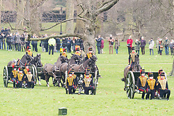 © Licensed to London News Pictures. 06/02/2018. London, UK.The King's Troop Royal Horse Artillery in full dress uniform, ride with horses and gun carriages taking part in a 41 gun salute to mark the anniversary of the Accession of Her Majesty The Queen.  Before their arrival in Green Park, the Band of the Royal Artillery play a selection of celebratory music close to the firing position.  71 horses pulling six First World War-era 13-pounder field guns will then dramatically come into action from the North of the Park to place the guns into position for the Royal Salute. Photo credit: Ray Tang/LNP