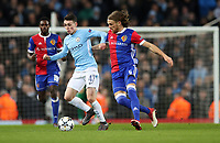 Football - 2017 / 2018 UEFA Champions League - Round of Sixteen, Second Leg: Manchester City (4) vs. FC Basel (0)<br /> <br /> Michael Lang of FC Basel and Phil Foden of Manchester City at The Etihad.<br /> <br /> COLORSPORT