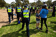 MELBOURNE, VIC - SEPTEMBER 19: Police and locals intermix as protesters flee during the Freedom protest on September 19, 2020 in Melbourne, Australia. Freedom protests are being held in Melbourne every Saturday and Sunday in response to the governments COVID-19 restrictions and continuing removal of liberties despite new cases being on the decline. Victoria recorded a further 21 new cases overnight along with 7 deaths. (Photo by Dave Hewison/Speed Media)