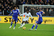 Nathan Dyer of Swansea city breaks past Willian and Filipe Luis of Chelsea. Barclays Premier League match, Swansea city v Chelsea at the Liberty Stadium in Swansea, South Wales on Saturday 17th Jan 2015.<br /> pic by Andrew Orchard, Andrew Orchard sports photography.