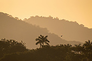Sunset over the Sierra Los Tuxlas mountains in Catemaco, Veracruz, Mexico. The region is known for the freshwater lake at the center of the Sierra de Los Tuxtlas, is a popular tourist destination known for free ranging monkeys, the rainforest backdrop and Mexican witches known as Brujos.