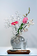 flower with water and incense as used for a at home shrine Japan