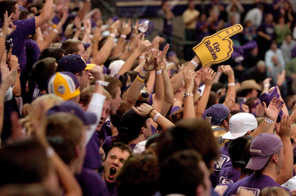 4 December 2005 .Student section for the University of Washington Huskies, cheering..Bank of America Arena, Seattle, WA.