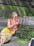 ONLINE FEES TO BE AGREED<br /> EXCLUSIVE<br /> Paris Hilton meeting monkeys in Ubud, Bali, Indonesia<br /> one seems to be taking an interest in Paris hilton's dress<br /> ©Exclusivepix Media