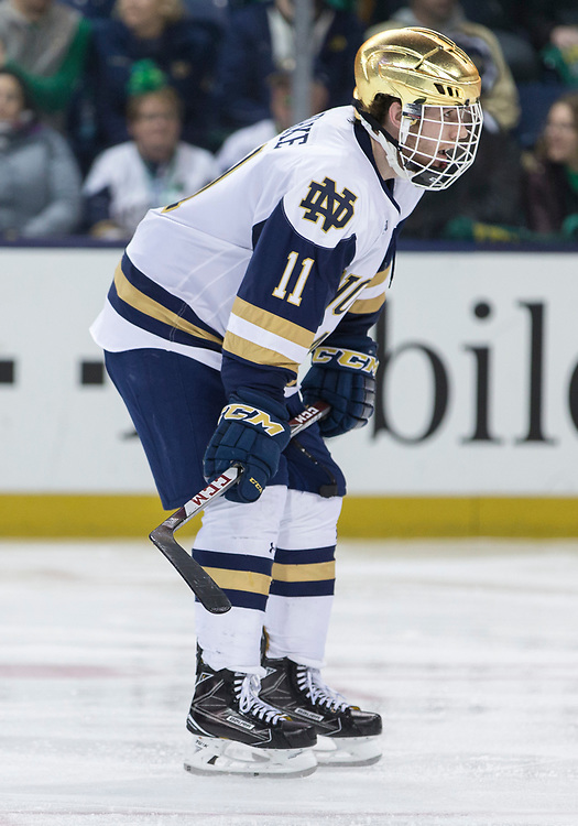 March 17, 2018:  Notre Dame forward Cal Burke (11) during NCAA Hockey game action between the Notre Dame Fighting Irish and the Ohio State Buckeyes at Compton Family Ice Arena in South Bend, Indiana.  Notre Dame defeated Ohio State 3-2 in overtime.  John Mersits/CSM