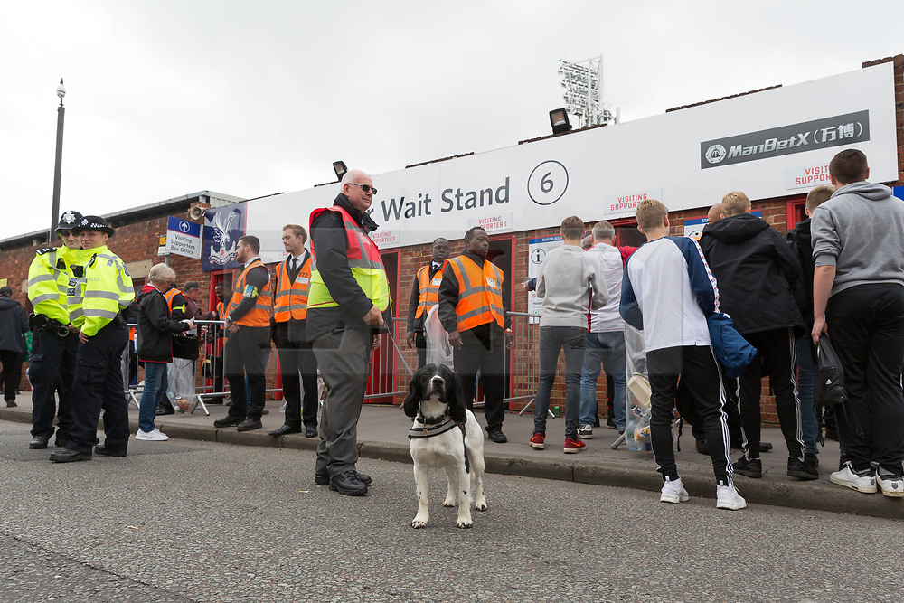 © Licensed to London News Pictures. 16/09/2017. LONDON, UK.  Police officers and a sniffer search dog outside Crystal Palace Football Club in London today.  Following the Parsons Green terror attack yesterday, additional police and visible security are being implemented, as the Prime Minister, Theresa May raised the Terror threat to critical. Photo credit: Vickie Flores/LNP