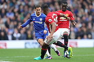 Eden Hazard of Chelsea is challenged by Luis Antonio Valencia of Manchester United. Premier league match, Chelsea v Manchester Utd at Stamford Bridge in London on Sunday 23rd October 2016.<br /> pic by John Patrick Fletcher, Andrew Orchard sports photography.
