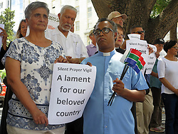 Wednesday 2nd October 2016.<br /> St. George's Cathedral,<br /> Cape Town,<br /> Western Cape,<br /> South Africa.<br /> <br /> #SaveSouthAfrica Silent Prayer Vigil In Cape Town!<br /> <br /> Concerned Citizens and Religious Leaders stand together in silent protest on the steps of St. George's Cathedral in Cape Town.<br /> <br /> Concerned Religious Leaders and other South Africans gathered together in silent protest in support of the call to #SaveSouthAfrica from 'the acute social crisis that has been brought about by corruption, mismanagement and political intrigue' as reported nationwide in the news. The campaign was formed under the banner of holding government leaders accountable to the Constitution and the values they have pledged to uphold as representatives of the people. The #SaveSouthAfrica Silent Prayer vigil was held at St. George's Cathedral in Cape Town, South Africa on Wednesday 2nd November 2016.<br /> <br /> Picture By:  Mark Wessels / RealTime Images.