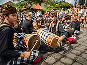 16 JULY 2016 - UBUD, BALI, INDONESIA:  A gamelan orchestra performs before the procession at the mass cremation in Ubud. Local people in Ubud exhumed the remains of family members and burned their remains in a mass cremation ceremony Wednesday. Almost 100 people were cremated and laid to rest in the largest mass cremation in Bali in years this week. Most of the people on Bali are Hindus. Traditional cremations in Bali are very expensive, so communities usually hold one mass cremation approximately every five years. The cremation in Ubud concluded Saturday, with a large community ceremony.    PHOTO BY JACK KURTZ