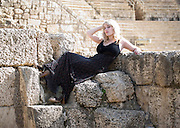 Israel, Caesarea, A young blond tourist stands in the ancient ruins. Model Release Available.