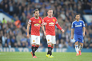 Wayne Rooney, the Manchester United captain and Juan Mata of Manchester United looking on. Barclays Premier league match, Chelsea v Manchester Utd at Stamford Bridge Stadium in London on Saturday 18th April 2015.<br /> pic by John Patrick Fletcher, Andrew Orchard sports photography.