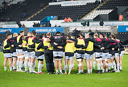 Saracens players huddle during the pre match warm up<br /> <br /> Photographer Simon King/Replay Images<br /> <br /> European Rugby Champions Cup Round 5 - Ospreys v Saracens - Saturday 13th January 2018 - Liberty Stadium - Swansea<br /> <br /> World Copyright © Replay Images . All rights reserved. info@replayimages.co.uk - http://replayimages.co.uk