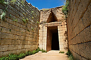 """Exterior of the Treasury of Atreus an Mycenaean """"tholos"""" beehive shaped tomb on the Panagitsa Hill at Mycenae Archaeological site . <br /> <br /> Visit our MYCENAEN ART PHOTO COLLECTIONS for more photos to download  as wall art prints https://funkystock.photoshelter.com/gallery-collection/Pictures-Images-of-Ancient-Mycenaean-Art-Artefacts-Archaeology-Sites/C0000xRC5WLQcbhQ<br /> .<br /> <br /> Visit our GREEK HISTORIC PLACES PHOTO COLLECTIONS for more photos to download or buy as wall art prints https://funkystock.photoshelter.com/gallery-collection/Pictures-Images-of-Greece-Photos-of-Greek-Historic-Landmark-Sites/C0000w6e8OkknEb8"""