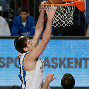 Anadolu Efes's Stanko Barac (C) during their Turkish Basketball League match Anadolu Efes between Mersin BSB at Sinan Erdem Arena in Istanbul, Turkey, Saturday, January 14, 2012. Photo by TURKPIX