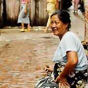 Woman sitting at a Mandalay alley