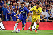Chelsea attacker Eden Hazard (10) battles for possession with Bristol Rovers defender Daniel Leadbitter (2) during the EFL Cup match between Chelsea and Bristol Rovers at Stamford Bridge, London, England on 23 August 2016. Photo by Matthew Redman.