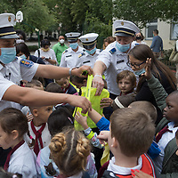 Police officers hand out gifts and inform students about traffic safety after an opening ceremony on the first day of schol in Budapest, Hungary on Sept. 1, 2020. ATTILA VOLGYI