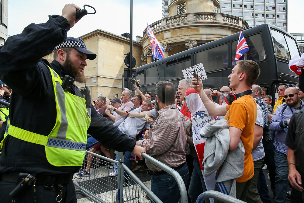 © Licensed to London News Pictures. 03/08/2019. London, UK. Police clashe with supporters of Stephen Yaxley-Lennon, known as Tommy Robinson during a protest in central London. Last month Tommy Robinson was given a nine-month prison sentence at Old Bailey after he was found guilty of contempt of court.Photo credit: Dinendra Haria/LNP