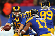 Rams quarterback Jared Goff #16 throws a pass to wide receiver Robert Woods #17 during the NFL game between Cincinnati Bengals and LA Rams at Wembley Stadium in London, United Kingdom. 27 October 2019
