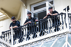 © Licensed to London News Pictures. 25/09/2021. Brighton, UK. Tactical Firearms Officers watch over from a balcony outside the conference . The first day of the 2021 Labour Party Conference , which is taking place at the Brighton Centre . Photo credit: Joel Goodman/LNP