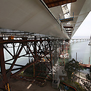 The San Francisco-Oakland Bay Bridge is under construction, and scheduled to open Labor Day 2013. The Self-Anchored Suspension Span (SAS) is the largest bridge of its kind in the world measuring 2,047 feet. This engineering and construction marvel raises the bridge building bar to new heights, as seen in these behind the scenes photos taken on Monday, March 18, 2013 This image shows the new spans on the left, and the original bridge on the right, that is still in use. (AP Photo/Alex Menendez)